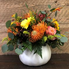 This colorful flower arrangement will add Fall Flair to your home or theirs! VisitiBlossom & Basket Boutique