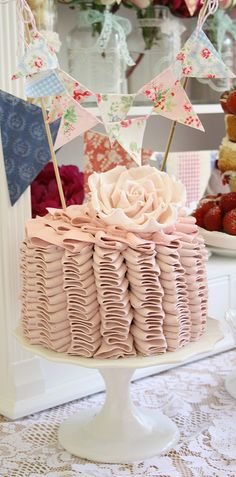 Ruffle cake by Cotton and Crumbs, via Flicker  LOoove the Ruffles, Color and Bunting... :) !