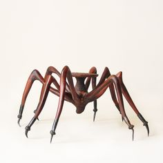 Tarantula Coffee Table... are you brave enough? I am not! I can admire its uniqueness and craft, but I think I would have nightmares!