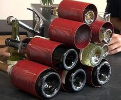 DIY Wine rack with cans.  Neat idea!  But without painting them.  Maybe some really cool vintage rusty ones.