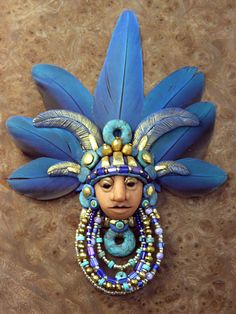 Polymer Clay and Mixed Media Together at Last... Aztec head focal bead by Laurie Grassel for the Friesen Project