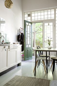 green tiles and door - A COZY SWEDISH HOME - style-files.com