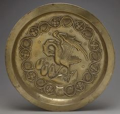 Plate with Pelican in her Piety Date: century Geography: Made in Dinant or Malines, Netherlands Culture: Netherlandish Medium: Brass Dimensions: Overall: x 3 in. x cm) Classification: Metalwork Medieval Art, Renaissance Art, Dragons, 15th Century, Metropolitan Museum, Middle Ages, Pottery Art, Art History, Metal Working