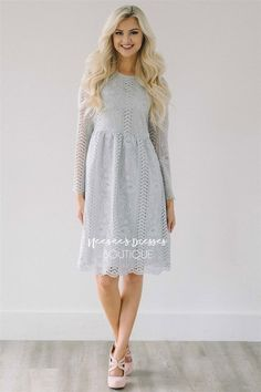 It was love at first sight when we saw this beautiful light silver lace dress! Don't let this one pass you by! Stunning lace dress features long sleeves and an elastic waist.