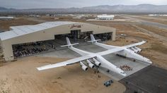 The Stratolaunch aircraft developed by Paul Allen's Vulcan Aerospace rolled out of its hangar in Mojave, Calif., for the first time Wednesday. (Stratolaunch Systems)
