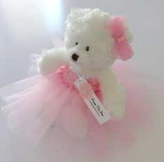PinkTutu Teddy Bear, Flower Girl Gift, Wedding Keepsake This bear is PERFECT for: flower girls, new baby girls, baby showers, bedroom décor, wedding décor, wedding keepsake, dance or ballerina recitals and pageants or just because! This bear wears an adorable, handmade tutu dress. I make a matching ear bow to complete the look. If you'd like to change any of the colors, please let me know. I'm happy to work with you to make it just right for your occasion. {Bear Details} Brand: I use…