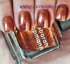 Phoenix Rising.  An orange, red, and gold-colored multicolor glass fleck shimmer. From the ltd collection called Rock This Town Trio - pre holiday release from Nordstrom 2012.