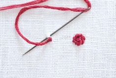 Learn how to embroidery the tiniest of floral designs with a few simple stitches. They're perfect for making embroidered jewelry!: How to Make a Tiny Rose