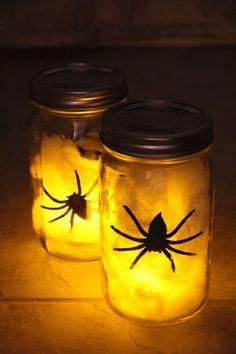 DIY Spider Lantern: Looking for a last minute Halloween decoration to light up your porch for trick-or-treaters? Put together these simple lanterns in ONLY 3 STEPS - using items you probably already have in your house! #Halloween, #DIY, #spider, #lantern, #craft
