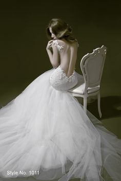 Pnina Tornai. And no, I'm not normally interested in wedding dresses.