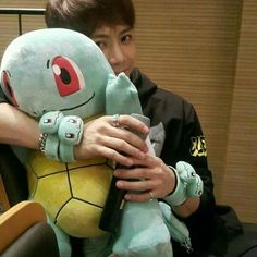So many squirtles on a squirtle named Jackson Wang.......why is this so cute