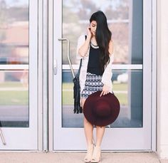 Black skirt, lace kimono, coin statement necklace, black and white tribal patterned skirt, burgundy floppy hat, and tan toe cutout booties