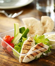 Chicken and Hummus Bistro Box: Hummus, grilled white chicken strips, cucumber, grape tomatoes and wheat pita.