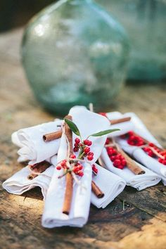 Cinnamon sticks and winter berries for an alternative napkin ring