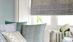 James Hare - Aurora Silks Fabric Collection - A subtly patterned dark grey window blind with scatter cushions featuring various subtle patterns in blue and cream shades Grey Windows, Blinds For Windows, Fabric Houses, Roman Blinds, Scatter Cushions, Soft Furnishings, Silk Fabric, Hare