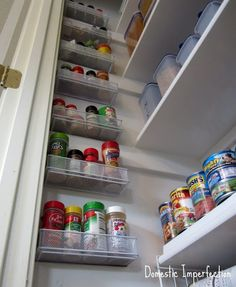 Pencil drawer organizers screwed to the wall for extra pantry storage....great use of space!