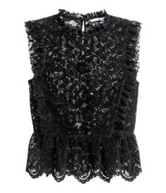 Black. Blouse in lace with a velvet finish. Small stand-up collar, ruffles at front and back continuing over shoulders, and opening at back of neck with