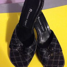 Shoes A size 5 1/2 Mule with Etienne Aigner logo the bottom heel was replace this summer. The heels are 2 1/2 they are very comfortable Etienne Aigner Shoes Mules & Clogs