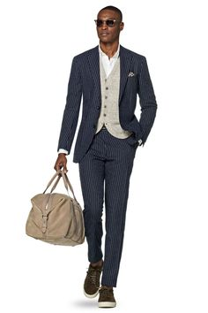 """Havana"" linen, silk and cotton mix navy and white stripe suit, £399. [link url=""http://eu.suitsupply.com/en_GB/suits/havana-navy-stripe/P5136.html?cgid=Suits"