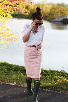 Pale pink knee skirt, belted, with a white button down & wellies (I'd sub boots)