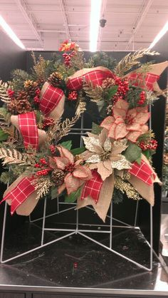 Burlap square wreath with red Christmas ribbon and burlap flowers...Robin Evans