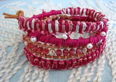 This bracelet make some great arm candy. This wrap bracelet is made with a mix of beads and macrame with a gold button clasp on brown leather. The