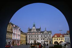 Renaissance and Baroque houses on Karlovo Square through arch of Baroque house in town of Kolin.