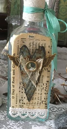 Altered Vintage Light Aqua Apothecary Bottle With Ceiling Tile Heart With Wings And Hope Theme - Ceiling Decorations Apothecary Bottles, Painted Wine Bottles, Altered Bottles, Vintage Bottles, Bottles And Jars, Glass Bottles, Perfume Bottles, Decorated Bottles, Antique Bottles