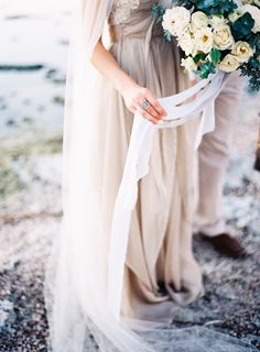 flowing gown + bouquet with ribbon | Photography: Jen Wojcik Photography - jenwojcikphotography.com Read More: http://www.stylemepretty.com/2015/03/13/breathtaking-seaside-wedding-inspiration/