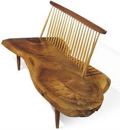 A George Nakashima walnut conoid bench, circa 1964. Beautiful craftsmanship.