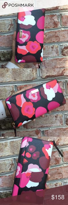 """🆕 Kate Spade Saffiano Floral Leather Wallet Brand new with tags Kate Spade saffiano leather Wallet Size: 4"""" X 8""""  12 credit card slots  3 main compartments  Middle compartment has a zipper for coins  2 inside Slots for bills   There is also an outer compartment Fully zipped   ✔️ Bundle Discounts  ✔️ Reasonable Offers through offer button  ❌ Low Balling  ❌ Trades kate spade Bags Wallets"""