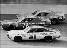 A.J. Foyt (21), Buddy Baker (71) and Richard Petty (43) race three abreast on the Banked oval of Texas World Speedway as they try for the lead of the 1972 Texas 500. Baker was the winner at an average speed of 147.059mph; with Foyt finishing 2nd and Petty captures 3rd position.  Image by Bettmann  CORBIS
