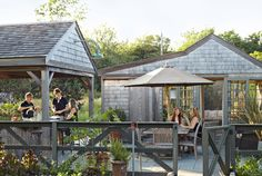 In landscape designer Sean Conway's garden, he had an open-air kitchen and an enclosed living room built—both outfitted with electricity and water.
