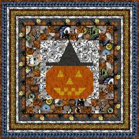 Ghosts and bats, owls and skeletons, black cats and haunted houses–all this and more surround this free Halloween quilt pattern created especially for Quilters Newsletter by Jason Yenter to showcase his Hallowgraphix collection from In the Beginning Fabrics. His border print gives the look of a pieced border without any stitching. What could be easier? Get this free Halloween quilt pattern today!