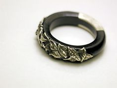 Silver and ebony wood ring.