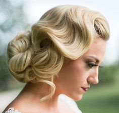 long bun with side finger wave