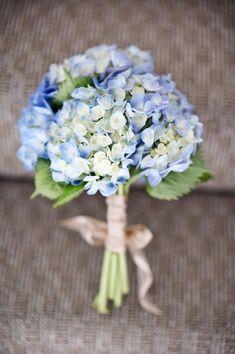 green and light blue hydrangea wedding bouquet