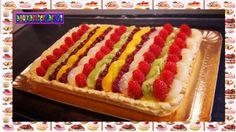 Pâte sablée vanillée , crème pâtissière à la vanille , fruits ( poires , framboises , kiwi , cerises et pêches ) ...