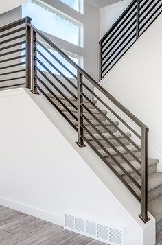 Elevate your lifestyle with a contemporary railing. Home design by Candlelight Homes, we build beautiful! Steel Railing Design, Staircase Railing Design, Interior Stair Railing, Modern Stair Railing, House Staircase, Home Stairs Design, Modern Stairs, House Design, Staircase Ideas