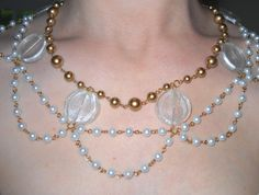 A white and gold pearl necklace accented with clear beads.  Based on Setsuna's wedding necklace from the Sailor Moon artbook.  $25.00