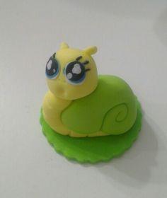 Snail figurine fondant cake topper