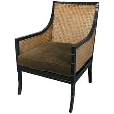 Faux Bamboo and Caned Black Lacquer Lounge Chair | From a unique collection of antique and modern lounge chairs at https://www.1stdibs.com/furniture/seating/lounge-chairs/
