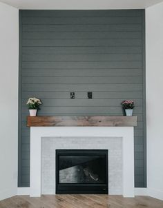 stunning fireplace This was originally just a corner in the living room, but the owners decided to add some drama to the space with this incredible fireplace! The dark shiplap works so well will the faux-wood mantle. Basement Fireplace, Fireplace Update, Farmhouse Fireplace, Home Fireplace, Fireplace Remodel, Living Room With Fireplace, Fireplace Surrounds, Fireplace Design, Home Living Room