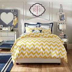 PBteen's take on chevron pattern in a teen girl's bedroom  with yellow and navy