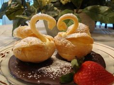 Cream puff swans - In some famous restaurant in Finland they make these for every Independent day - and then they give it a blue dessert sauce lake to swim on, not chocolate like here. Swan is Finland's national bird.