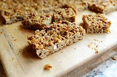 Granola Bars   ~ Oats, canola oil, butter, salt, brown sugar, honey, apple juice, molasses, vanilla, Rice Krispies, wheat germ, pecans, and almonds ~ recipe looks so easy. Would make great gifts.