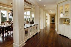 love the dark wood floors and white panels
