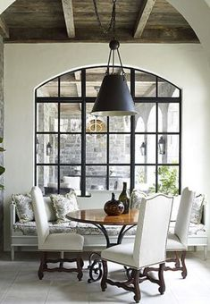 Arched steel doors and windows-- architect Bill Litchfield. Arched steel windows define many of the spaces in this house. Interiors by Jackye Lanham, They look like Cantera Doors. Steel Doors And Windows, Black Windows, Iron Windows, Ceiling Windows, Farmhouse Side Table, Banquette Seating, Room Lights, Decoration, Designer