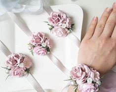 Bridal Blush dusty pink flower wrist corsage Dusty pink grey flower corsage Bridal flower corsage Alpi , Blush dusty pink flower wrist corsage Dusty pink grey flower corsage Bridal flower corsage [ Blush dusty pink flower wrist corsage Dusty pink g. Bridesmaid Corsage, Corsage Wedding, Bridesmaid Bracelet, Bridesmaid Flowers, Wedding Bouquets, Blush Flowers, Bridal Flowers, Paper Flowers, Buttonhole Flowers