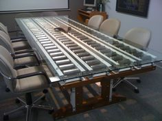 Nautilus conference table. Steel conveyor pins, pallet racking beams, walnut, glass. #office #design #table #finart